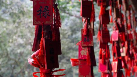 Traditional chinese decoration, red lucky wishes in chinese buddhist temple located in sacred mountain Emei , China Stock Photo