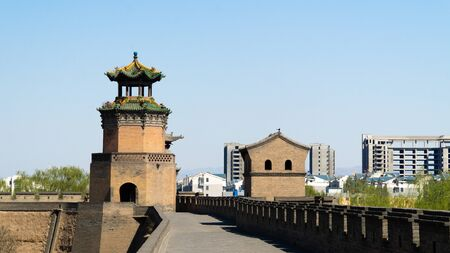 Ancient wooden watchtower in the corner of historical Pingyao City Wall, ancient chinese architecture, China Stock fotó - 128187758