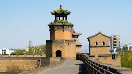 Ancient wooden watchtower in the corner of historical Pingyao City Wall, ancient chinese architecture, China