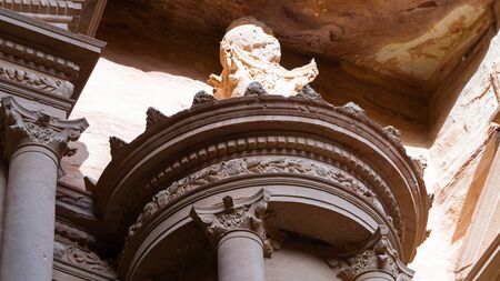 The Nabatean mausoleum Al-Khazneh or The Treasure located in heart of Prehistoric Rock Carved City of Petra, Wonder of The World, close up to details, Jordan