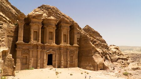 Stunning view of Ad Deir – the Monastery hidden between rocky hills of of Prehistoric Rock Carved City of Petra, Jordan Stok Fotoğraf