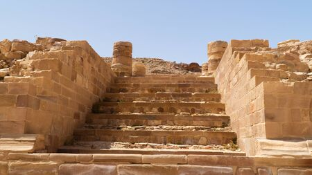 Sandstone steps leading to The Great Temple, prehistoric rock carved city of Petra, Jordan.