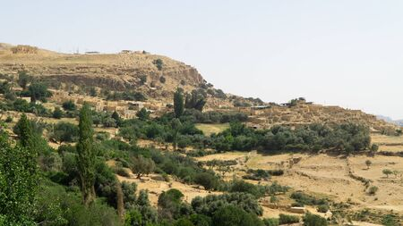 View of the Dana village situated on the edge of the Dana Reserve, panoramatic view of typical middle east landscape Jordan.