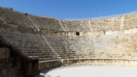 View of The Western Roman Theatre situated in the ancient greco-roman city of Umm Qais, Jordan