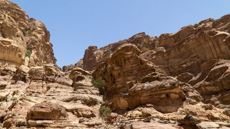 View of rocky hills and mountains in prehistoric rock carved city Petra,   the capital of the kingdom of the Nabateans in ancient times, Jordan.