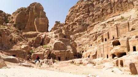 Beautiful Prehistoric Rock Carved City Petra,   Bedouin riding a horse, Jordan