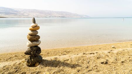 A little tower from pebble on the Dead sea shore, Jordan