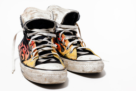 fashon: Worn and dirty sneakers isolated on white background