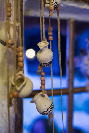Decorative pitchers on a string in a rural hut Stock Photo