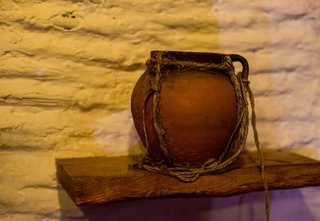 Old earthenware jug with crack. Decorative jug in a rural hut