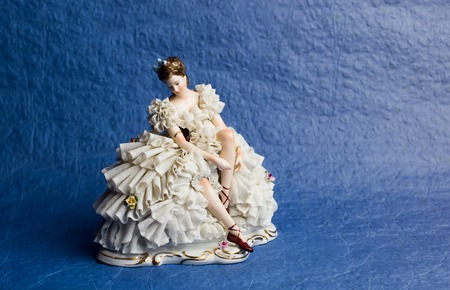 statuette of a ballerina on a blue background