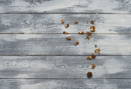 Greek nuts on a light wooden background