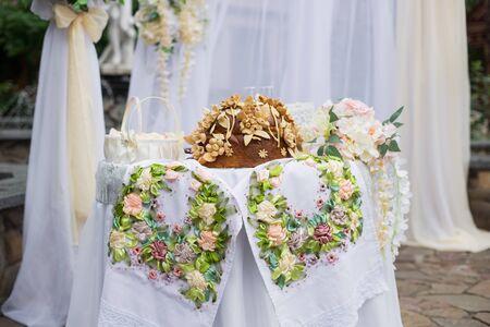 Traditional Ukrainian wedding bread (loaf). Wedding ceremony and wedding decorations, arch.