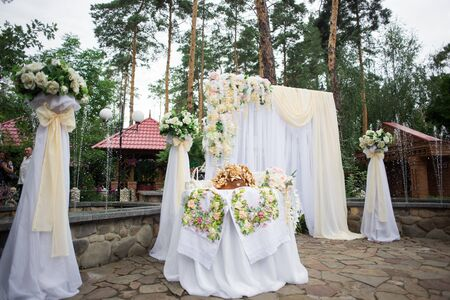 Wedding ceremony scenery, arch. Wedding decor for newlyweds