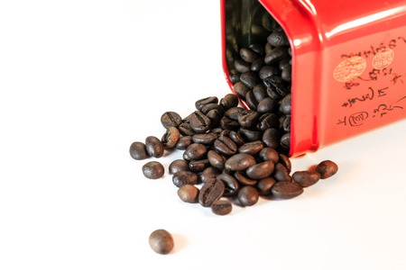 Coffee beans spilled out of a jar - isolated