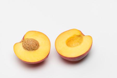 Nectarine cut in half over white background Stok Fotoğraf