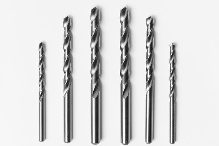 Drill bits of different sizes isolated over white background Stok Fotoğraf