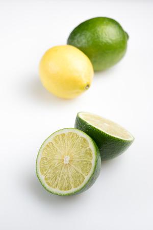 Fresh cut lime with lemon  isolated Stok Fotoğraf