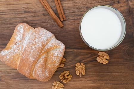 Breakfast - sweet walnut bun with glass of milk Stok Fotoğraf