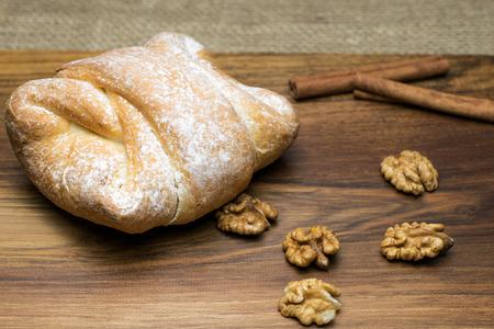 Breakfast - sweet walnut bun with cinnamon Stok Fotoğraf
