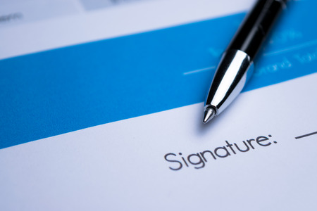 sign contract: Agreement - signing a contract Stock Photo