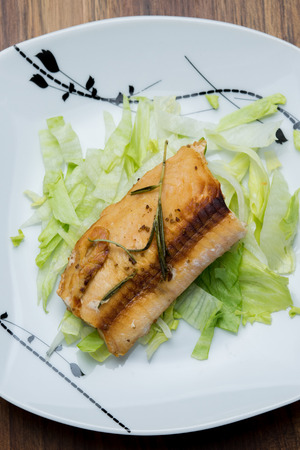 Salmon fillets served on a plate with mixed salad Stok Fotoğraf