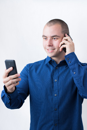 Man with two smart phones photo