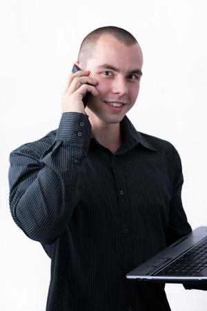 Man browsing internet on his laptop while calling