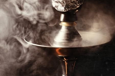 Detail shot of hookah with smoke