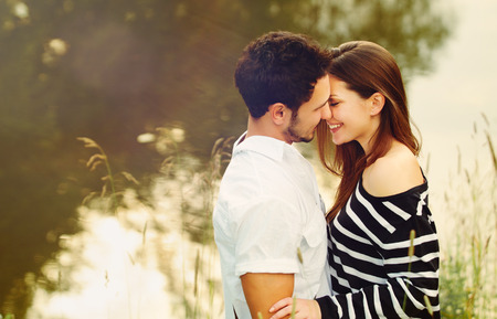 happy romantic sensual couple in love together outdoors on summer vacation Foto de archivo