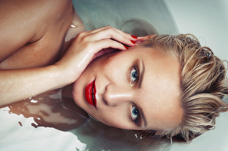 caucasian water drops: portrait of a beautiful glamourous blonde in water, spa concept, close up portrait