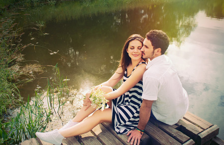 sensual romantic couple in love on pier at the lake outdoor in summer day, beauty of nature, harmony concept