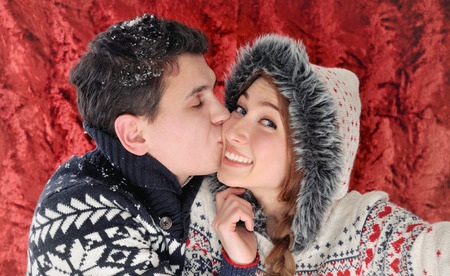 new love: happy young couple enjoying christmas time