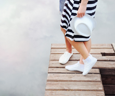 couple kissing on the pier near lake in hot summer day, summer concept photo