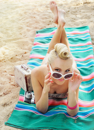 hot body: happy cute hot body young woman lying on the beach with colorful details, relax concept, travel Stock Photo