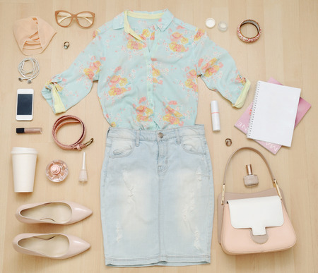 stylish casual set of clothes and accessories and stuff for urban woman in soft colors, fashion concept
