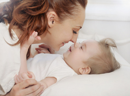 born: mother and her newborn baby, maternity concept, soft image of beautiful family