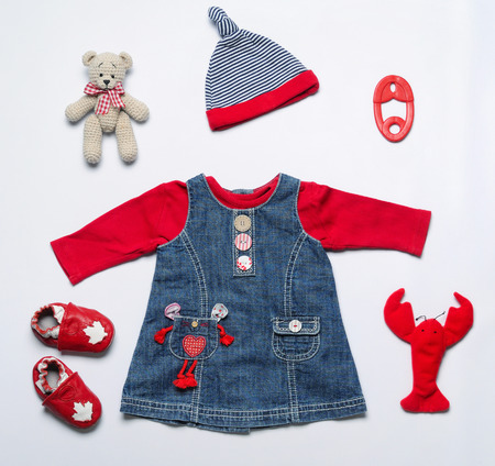 top view fashion trendy look of baby girl clothes and toy stuff, baby fashion concept Foto de archivo