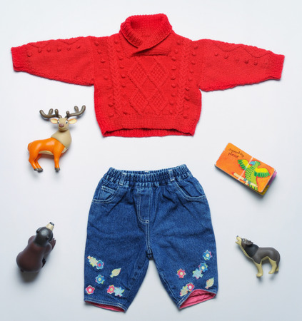 top view fashion trendy look of baby clothes and toy stuff, baby fashion concept Foto de archivo