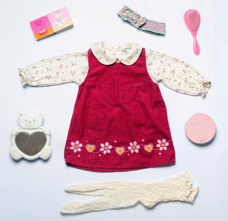 baby stuff: top view fashion trendy look of baby girl clothes and toy stuff, baby fashion concept Stock Photo