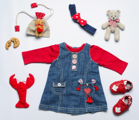 stuff toy: top view fashion trendy look of baby girl clothes and toy stuff, baby fashion concept Stock Photo