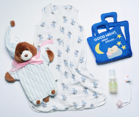 top view set of fashion trendy nighttime stuff and toys for newborn baby, baby fashion concept