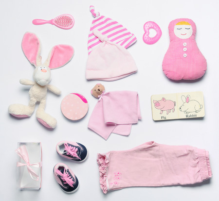 top view set of fashion trendy pink stuff for baby girl, baby fashion concept Foto de archivo