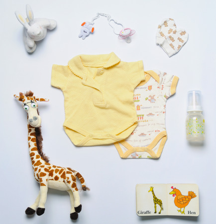 top view set of fashion trendy stuff and toys for newborn baby, baby fashion concept Foto de archivo