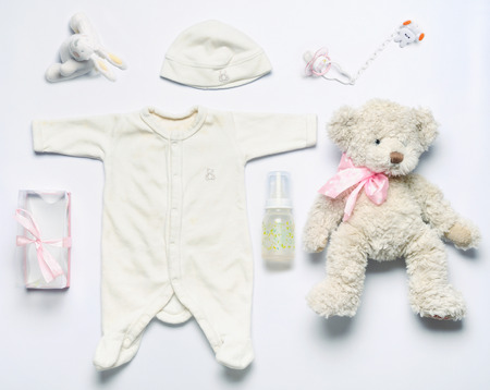 pink teddy bear: top view set of fashion trendy stuff for newborn baby girl, baby fashion concept