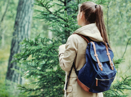 discovering: young woman discovering nature in the forest environment, travel lifestyle concept