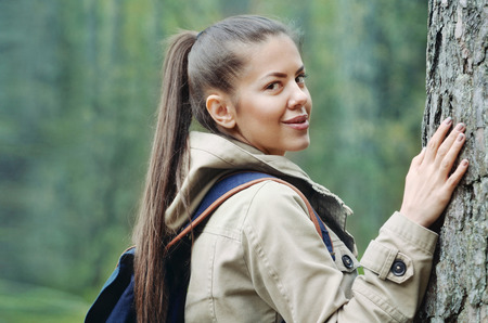 young woman enjoing and discovering nature in the forest, travel lifestyle concept Stock Photo