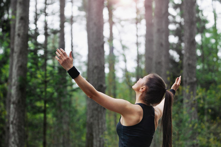 healthy lifestyle fitness sporty woman running early in the morning in forest area, healthy lifestyle concept. Stock Photo