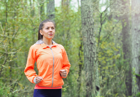 healthy lifestyle fitness sporty woman running early in the morning in forest area, healthy lifestyle concept photo