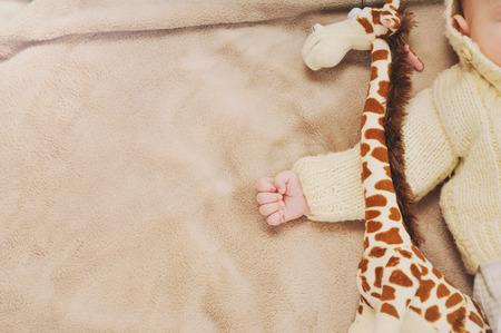 sleep: sleeping cute newborn baby, maternity concept, soft image of beautiful family